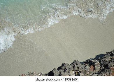 waves breaking on beach from above