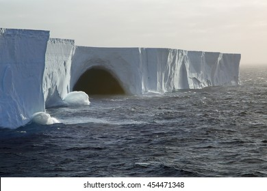 Waves breaking on gigantic tabular iceberg in the Drake Passage near Antarctica (two miles long, probably broke off from the Ross Ice Sheet)