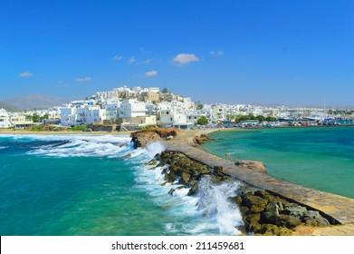 Waves breaking on Naxos town pier, Naxos island, Cyclades archipelago, Greece