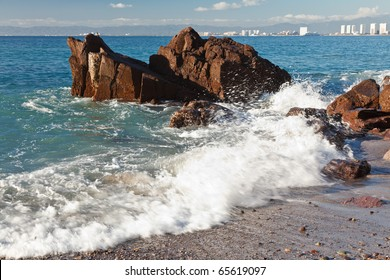 Waves breaking on the rocks of Banderas Bay, Puerto Vallarta, Mexico