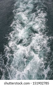 Waves caused by a ship at sea.