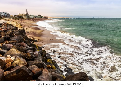 Waves and the coastline of Swakopmund German colonial town, Namibia