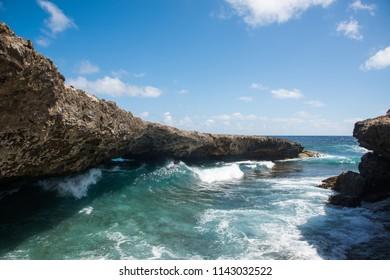 Waves coming through Natural Bridge at Shete Boka natural park, Curacao Island
