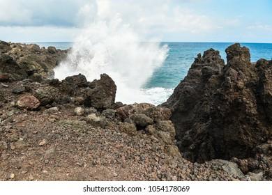 Waves crash against the shore in Wai'anapanapa Park on the Road to Hana
