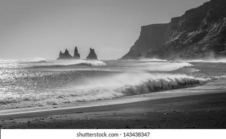Waves crash into the rocky black beaches near Vik, Iceland.