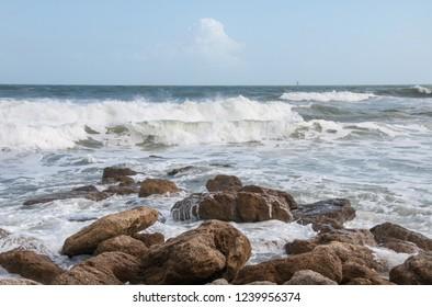 Waves crash on a rocky beach.