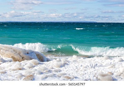 Waves crash on a winter beach on the shores of Lake Michigan in northern Michigan