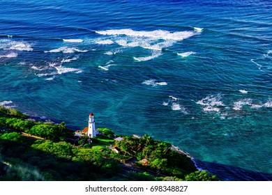 The waves crash towards Diamondhead Lighthouse in Honolulu, Hawaii