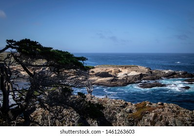 Waves crash upon the rocky beach at Point Lobos State Natural Reserve in Monterey, California.