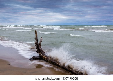 Waves Crashing Against Driftwood on a Lake Huron beach - Pinery Provincial Park, Ontario, Canada