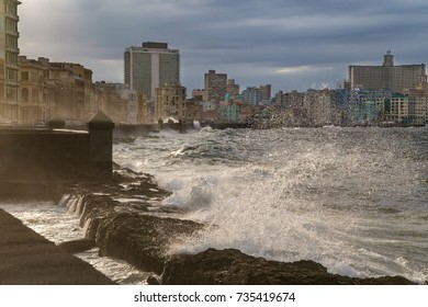 Waves crashing against El Malecon promenade in Havana