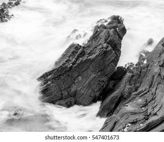 Waves Crashing Against Rocks in Devon O black and white long exposure photography
