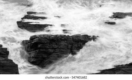 Waves Crashing Against Rocks in Devon H black and white long exposure photography
