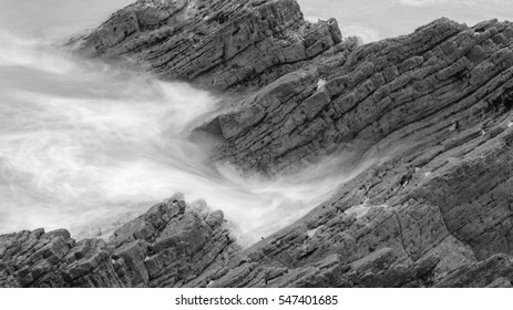 Waves Crashing Against Rocks in Devon M black and white long exposure photography
