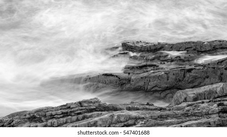 Waves Crashing Against Rocks in Devon K black and white long exposure photography