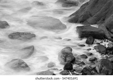 Waves Crashing Against Rocks in Devon D black and white long exposure photography