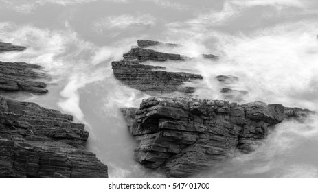 Waves Crashing Against Rocks in Devon E black and white long exposure photography