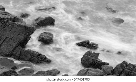 Waves Crashing Against Rocks in Devon C black and white long exposure photography