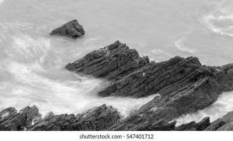 Waves Crashing Against Rocks in Devon L black and white long exposure photography