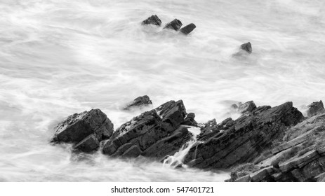 Waves Crashing Against Rocks in Devon N black and white long exposure photography