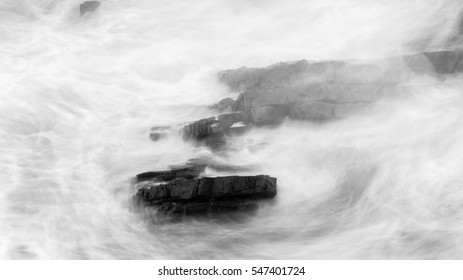 Waves Crashing Against Rocks in Devon G black and white long exposure photography