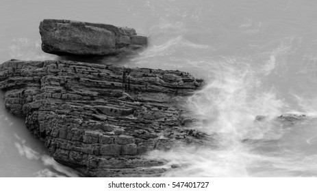Waves Crashing Against Rocks in Devon I black and white long exposure photography