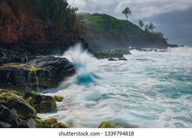 Waves crashing against rocks in Hawaii