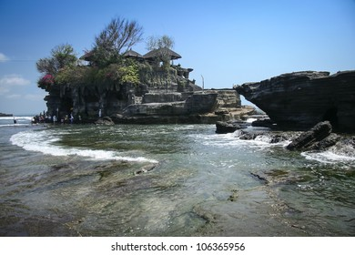 waves crashing around the sea temple of tanah lot built on a rocky outcrop of the coast of bali indonesia