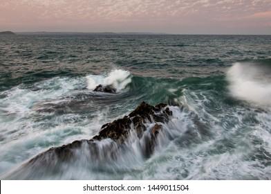 Waves crashing at Mevagissey, Cornwall UK