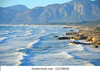 Waves crashing off the coastline near Hermanus, Western Cape, South Africa