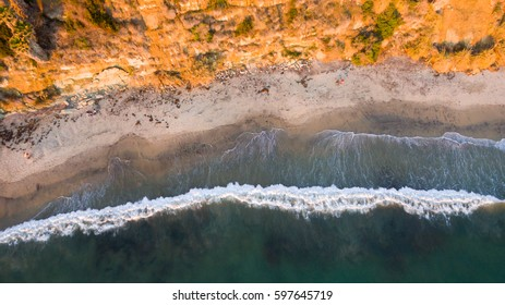 Waves crashing on the beach in Encinitas, California just before sunset