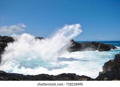 Waves crashing on black rocks, Gouffre Etang-Salé, Reunion Island, France