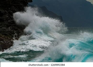Waves crashing on the headlands on the north shore of Kauai, Hawaii.
