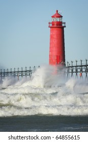 Waves crashing on lighthouse. Grand Haven lighthouse on Lake Michigan. Vertical format.
