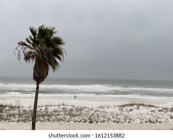 Waves crashing on Pensacola Beach on cloudy day in January