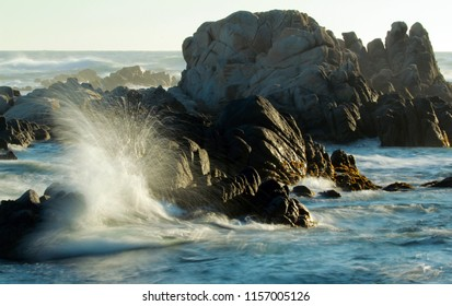 Waves crashing on rocks on coastline of central California, Pacific Grove, USA