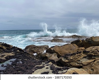 Waves crashing on rocks. Kilcunda surf beach. Victoria. Australia