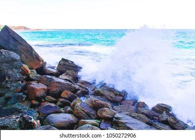 Waves crashing on rocks at Manly Beach south of Sydney, Australia