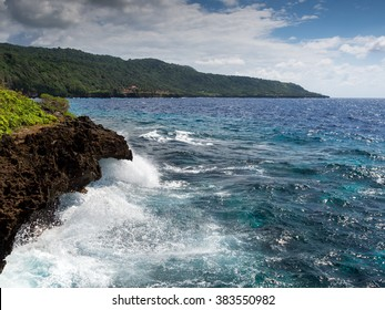 Waves crashing on a rocky coastline, Christmas Island, Australia