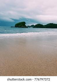 Waves crashing on the sand of a beach