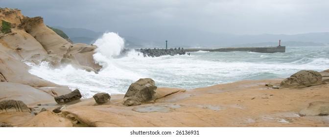 Waves crashing on the shore during typhoon season at Yehliu geo park