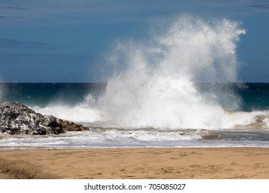 Waves crashing onto beach at the Napali coast, Kauai Hawaii at Hanakapia'i beach