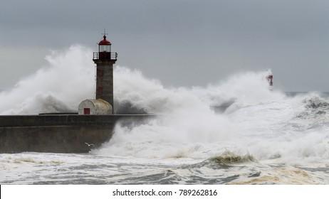 Waves crashing over a lighthouse
