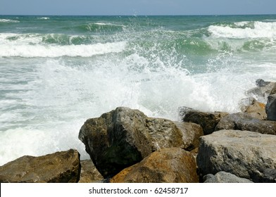 Waves crashing over the rocks in the surf at New Smyrna Beach, Florida.