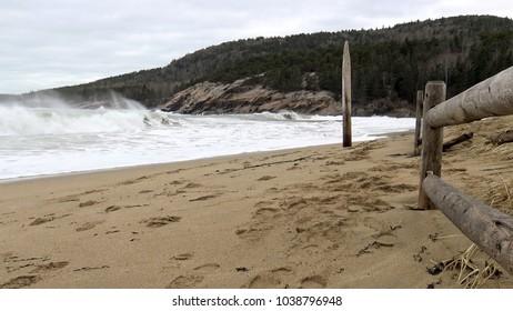 Waves crashing at sand beach Acadia National Park