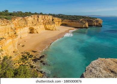 Waves at famous beach of Praia da Marinha. This beach is a part of famous tourist region of Algarve.