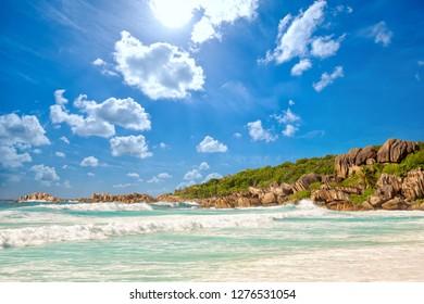 Waves at Grande Anse beach in La Digue Island, Seyshelles