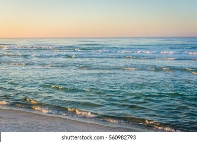 Waves in the Gulf of Mexico at sunrise, in Panama City Beach, Florida.
