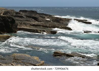 Waves hit rocks on Ireland coastline