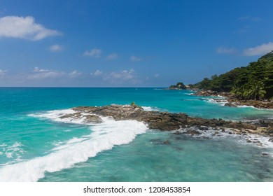 Waves hitting the tropical islands of the Seychelles